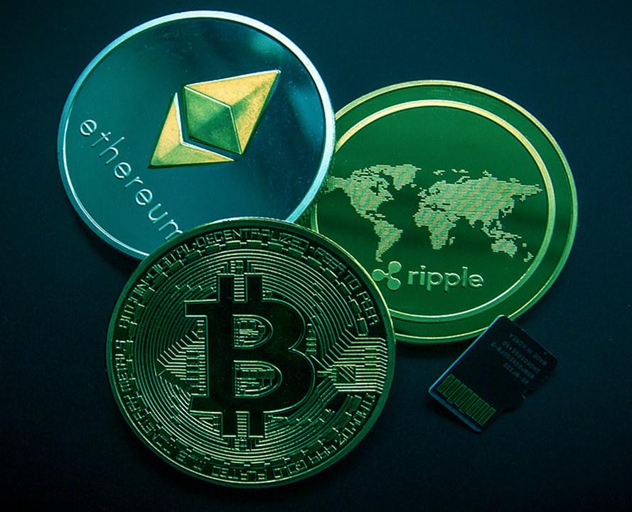 Carte prepagate per criptovalute, immagine con alcuni tokens